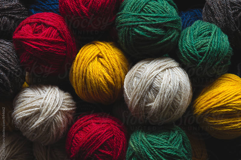 Colorful yarn balls by Pixel Stories for Stocksy United