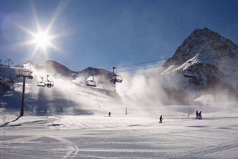 Ski resort with snow making at work by Miquel Llonch for Stocksy United