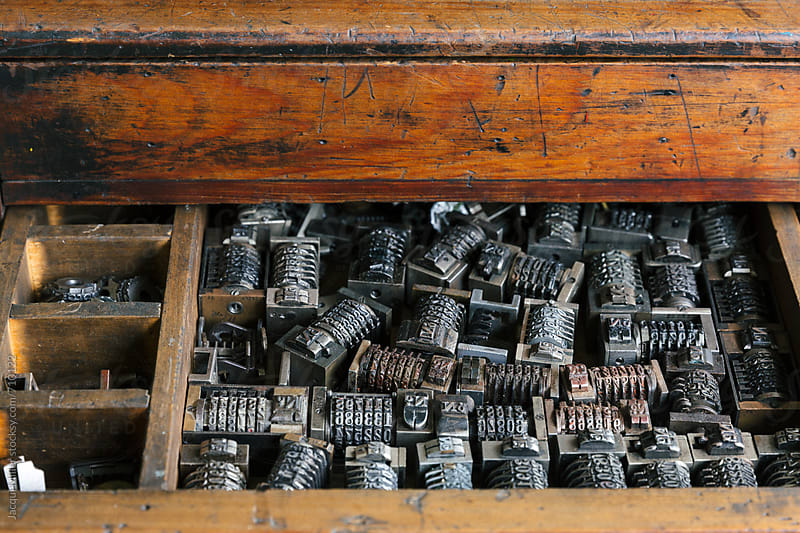 Close up of old wood drawer filled with vintage metal numbering inserts for printer by Jacqui Miller for Stocksy United