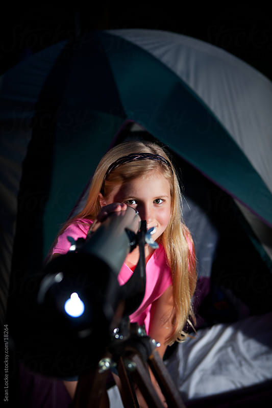 Camping: Girl Uses Telescope in Backyard by Sean Locke for Stocksy United