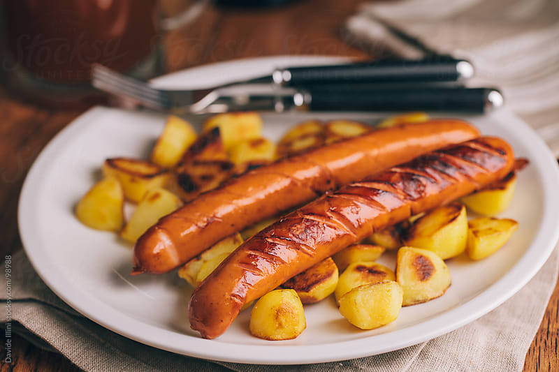 Sausage with potatoes. by Davide Illini for Stocksy United