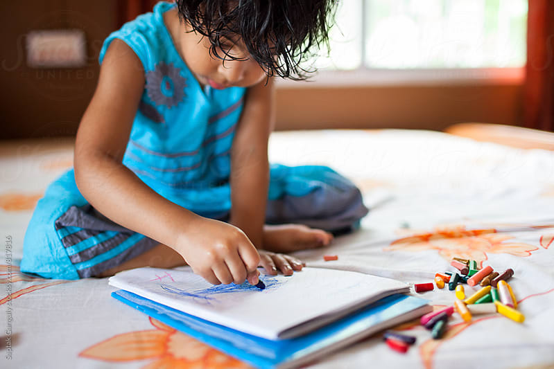 Cute little girl drawing with crayons by Saptak Ganguly for Stocksy United