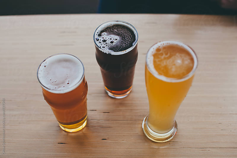 Three types of craft beer  by Drew Schrimsher for Stocksy United