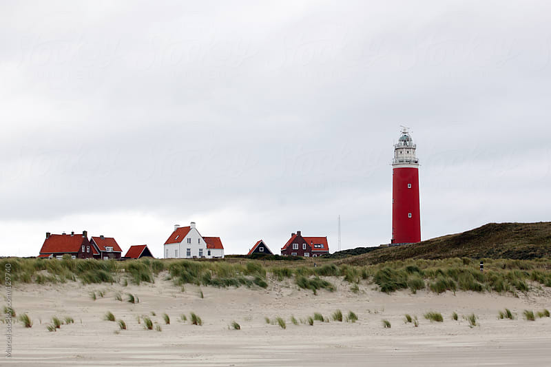 Lighthouse and tiny village in The Netherlands by Marcel for Stocksy United