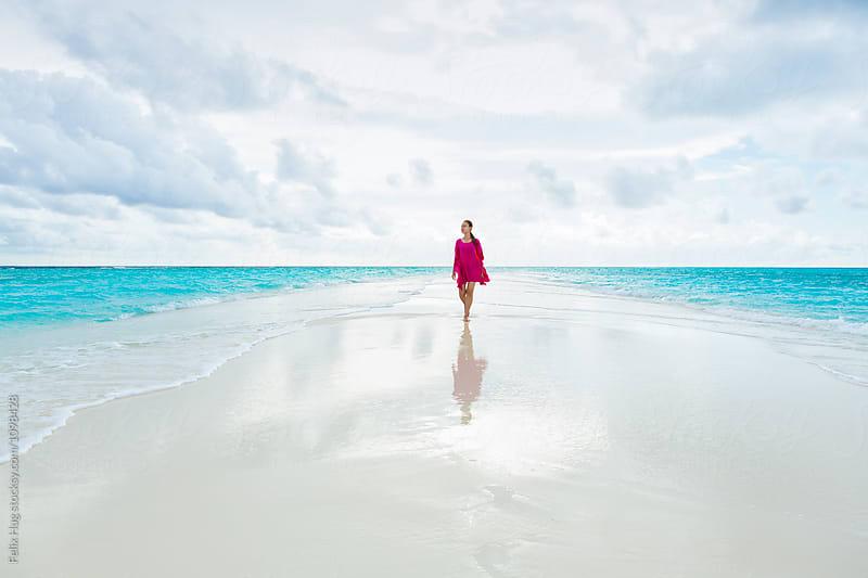 Woman walking on Sandbank by Felix Hug for Stocksy United