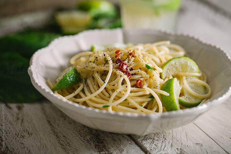 Spaghetti with lime by Davide Illini for Stocksy United