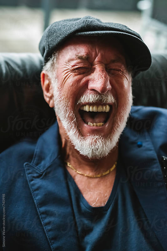 Happy senior man laughing by Simone Becchetti for Stocksy United