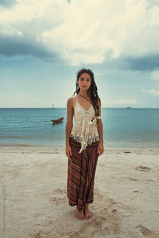 Young hippie standing on the sandy beach. by Marija Savic for Stocksy United