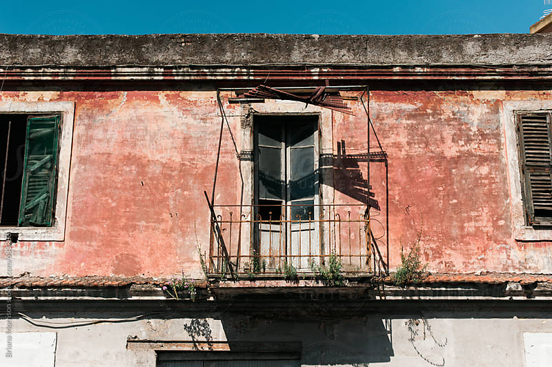 An old Roman Balcony in the Summer Sun by Briana Morrison for Stocksy United