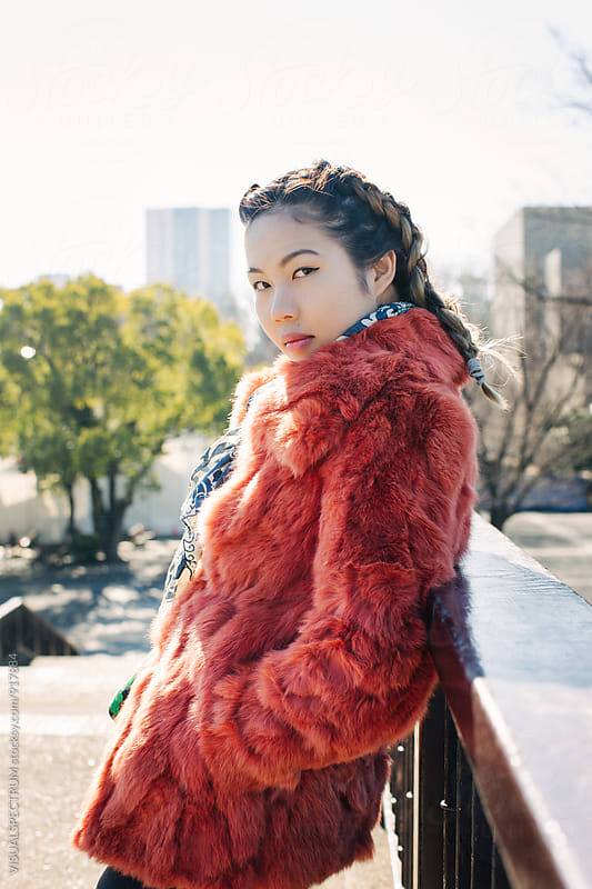 Outdoor Portrait of Young Pretty Asian Girl in Red Fur Coat by VISUALSPECTRUM for Stocksy United