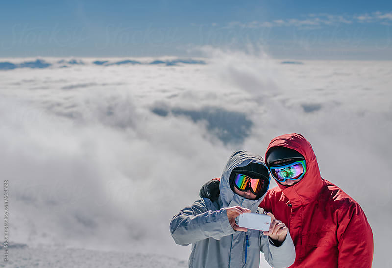 two snowboarders selfie by Peter Meciar for Stocksy United