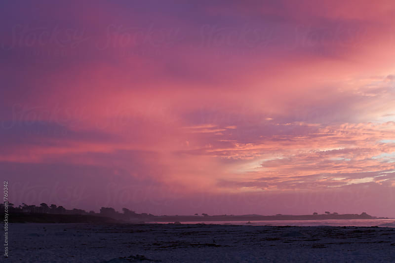 colorful sky over beach at dusk by Jess Lewis for Stocksy United
