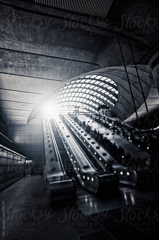 People on escalator in the subway station, London by GIC for Stocksy United