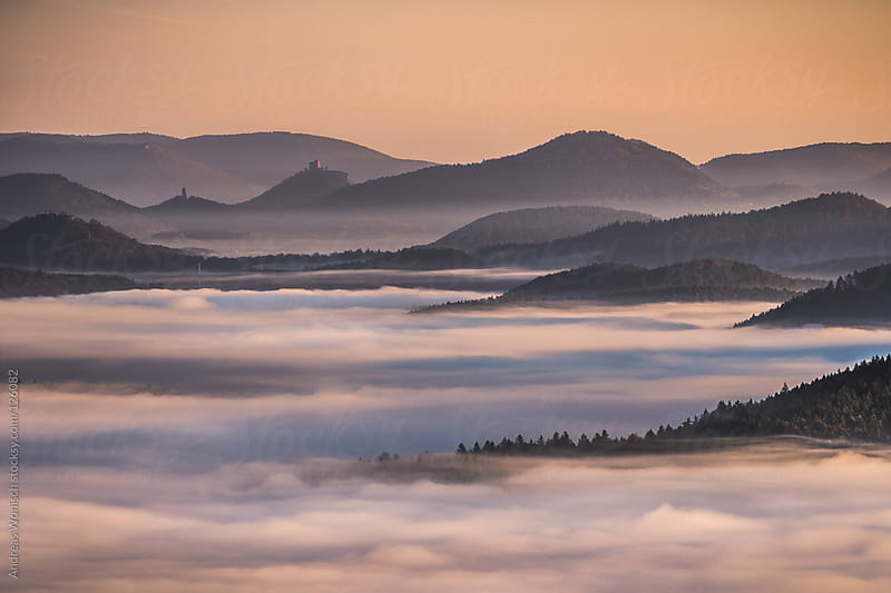 Hills in Fog by Andreas Wonisch for Stocksy United