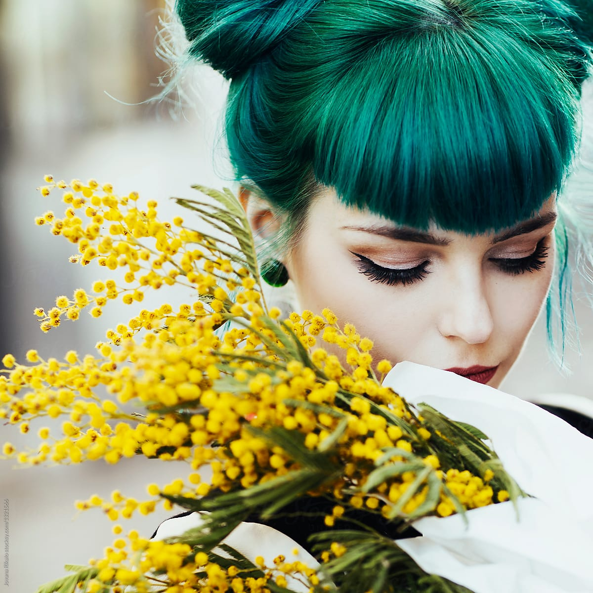Portrait Of A Beautiful Young Woman Holding Yellow Flowers Stocksy