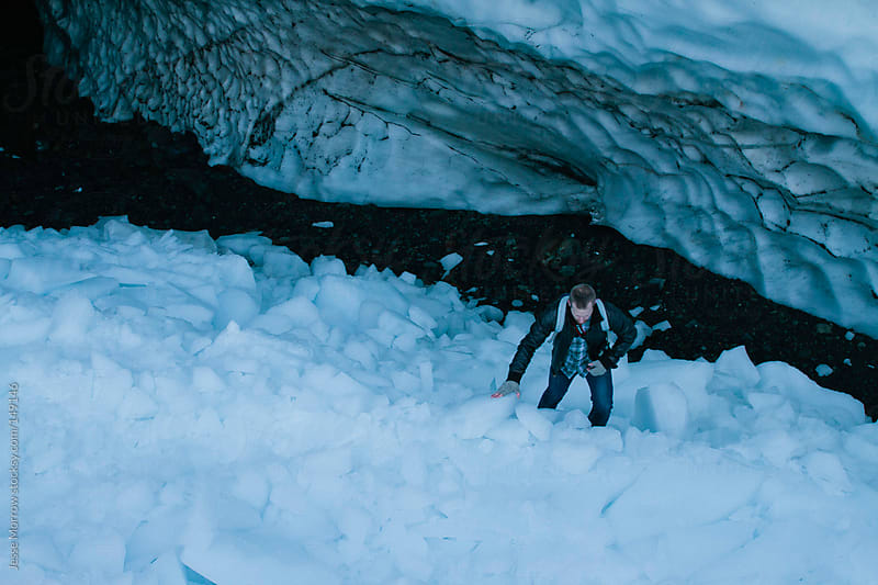 Man in Cave by Jesse Morrow for Stocksy United