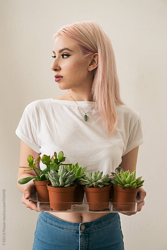 Blonde woman holding tray of succulents by Danil Nevsky for Stocksy United
