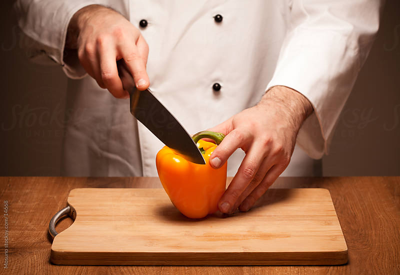 Cutting Pepper by Mosuno for Stocksy United