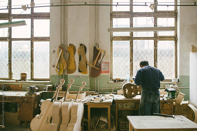 Violoncello maker at work by MaaHoo Studio for Stocksy United