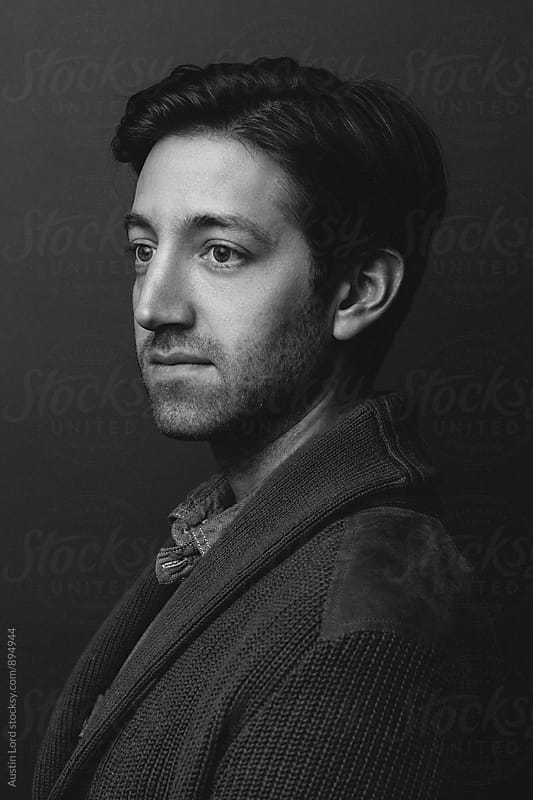 Black and white headshot of a man  by Austin Lord for Stocksy United