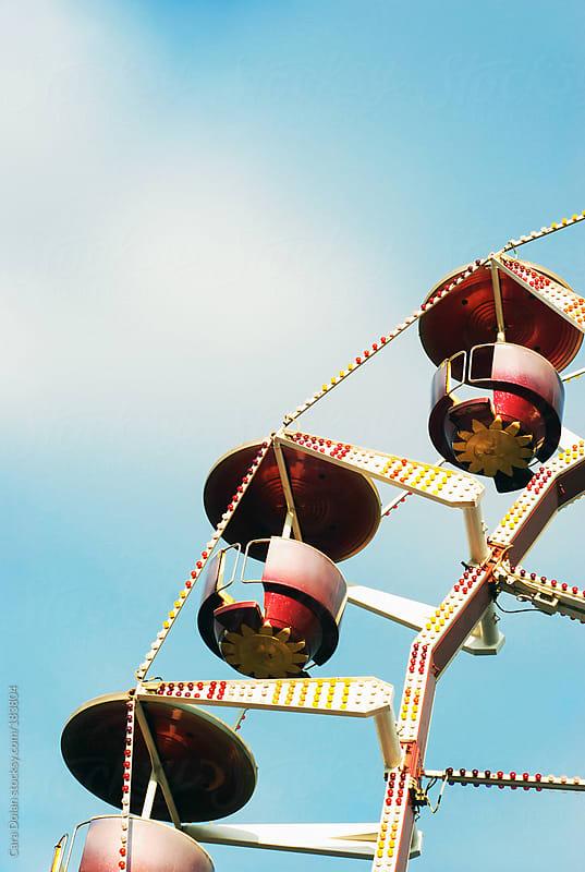 Ferris wheel cars against a blue summer sky by Cara Dolan for Stocksy United