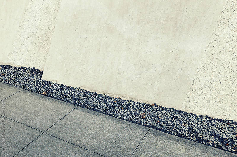Urban sidewalk and wall  by Paul Edmondson for Stocksy United