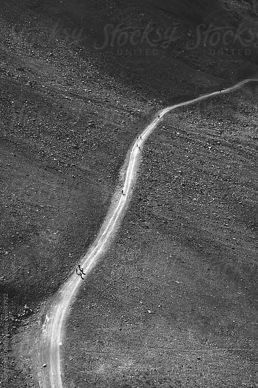 Aerial view of hikers on mountain road. Black and white photo. by BONNINSTUDIO for Stocksy United