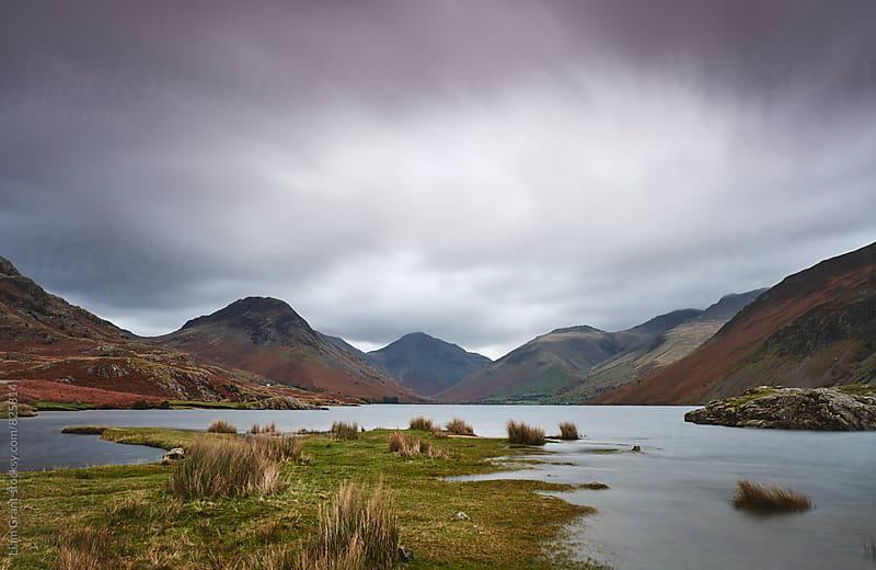 Rain clouds over Scafell and Great Gable. Wastwater, Cumbria, UK. by Liam Grant for Stocksy United