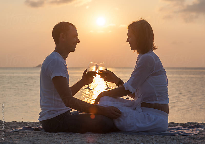 Man and Woman Drinking Wine at Sunset by Mosuno for Stocksy United