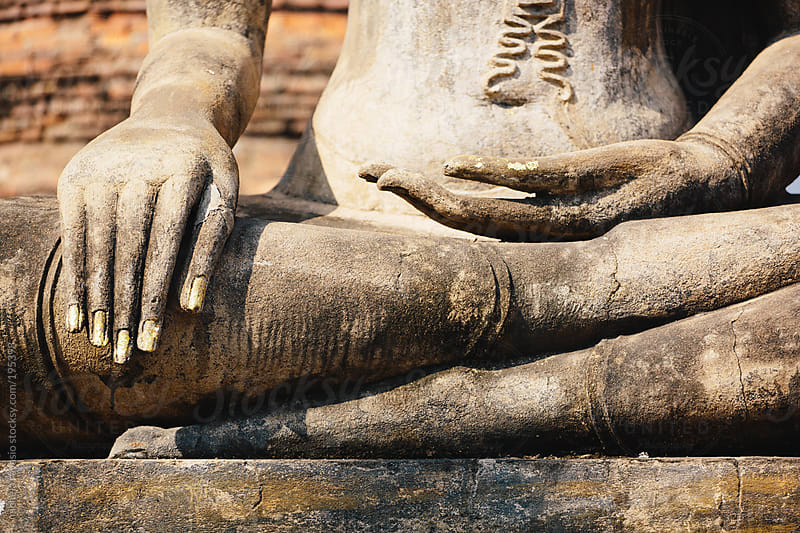 Detail of hands of a Buddha statue by michela ravasio for Stocksy United