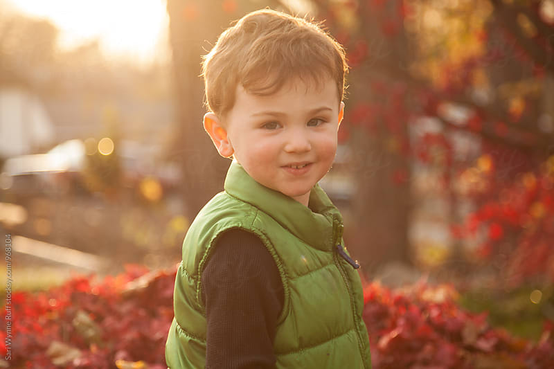 Little Boy Backlit by Sun by Sari Wynne Ruff for Stocksy United