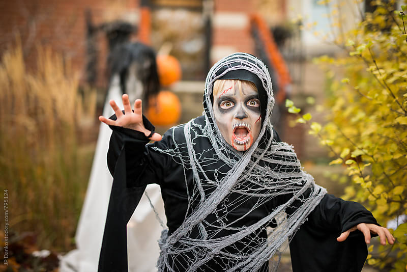 Scary Boy Dressed Up As Zombie Ghoul Halloween Costume Outdoors at House by JP Danko for Stocksy United