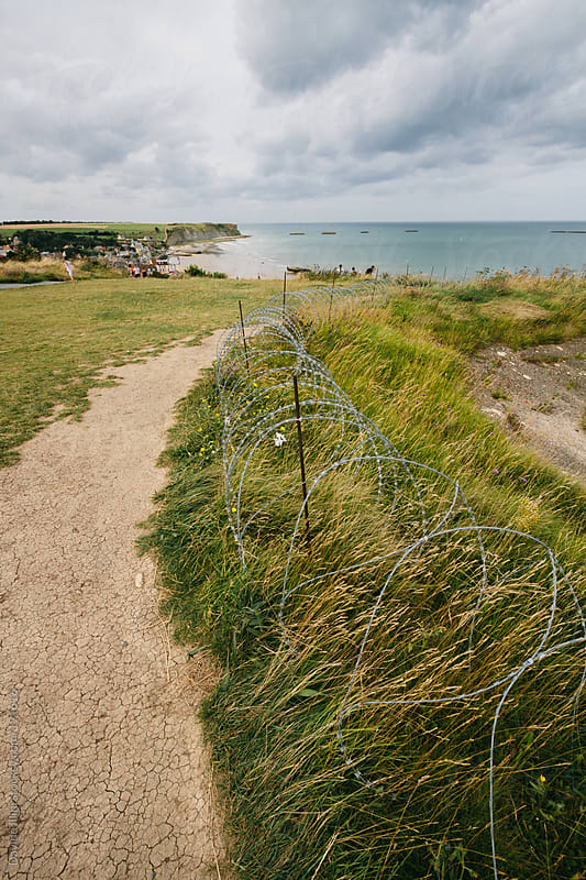 Normandy Landings, remains of artificial port at Arromanches-les-Bai ns, France by Davide Illini for Stocksy United