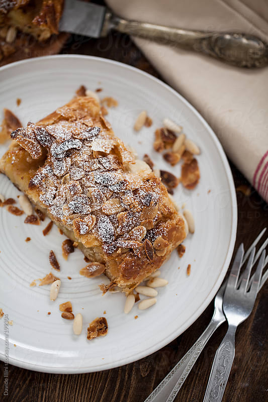 Apple strudel with almonds by Davide Illini for Stocksy United
