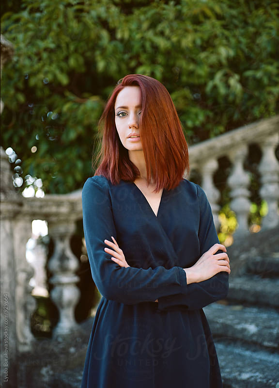 Portrait of a redhead woman by Lyuba Burakova for Stocksy United