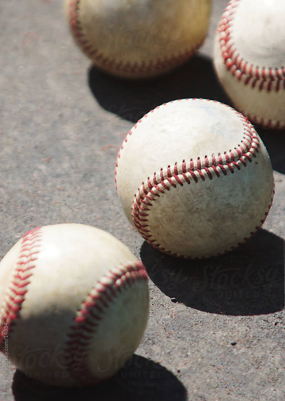 A group of baseballs.  by Tana Teel for Stocksy United