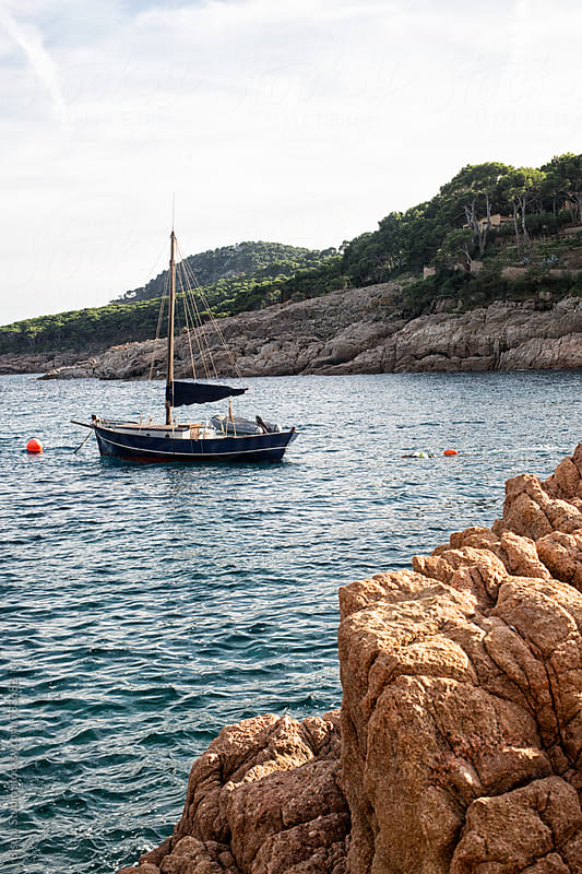 Sailboat in the mediterranean sea, Cadaqués by Bisual Studio for Stocksy United