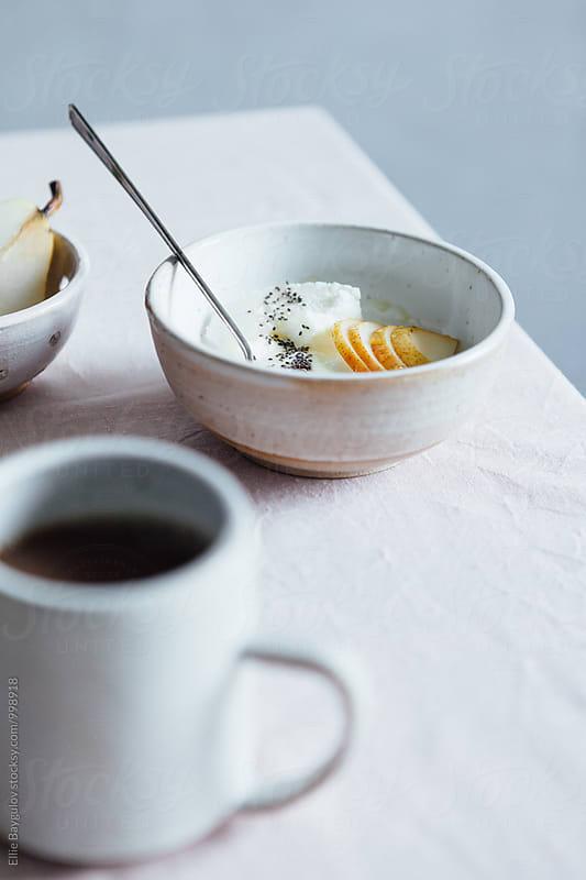 Pear yogurt bowl by Ellie Baygulov for Stocksy United