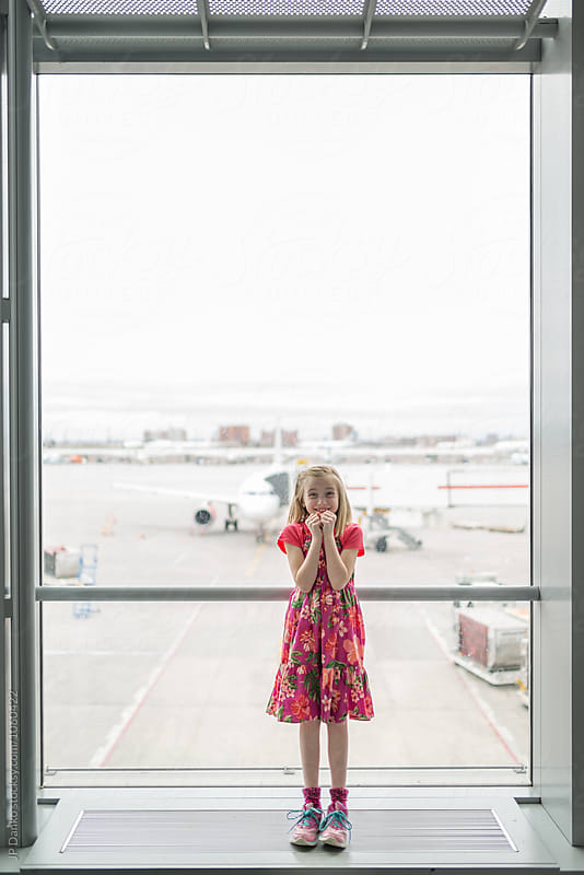 Little Girl Excited Travel and Flight at Modern Airport Traveller Lounge by JP Danko for Stocksy United