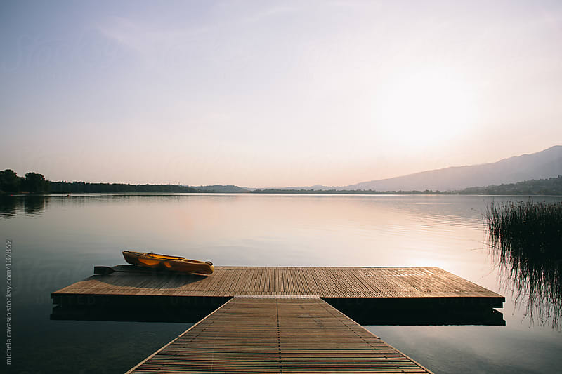 Canoe on the pier by michela ravasio for Stocksy United