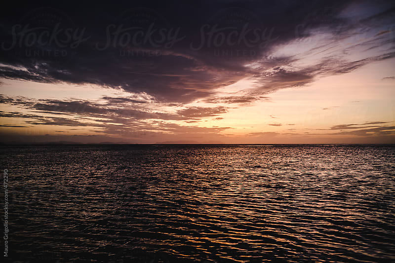 Seascape at sunset by Mauro Grigollo for Stocksy United