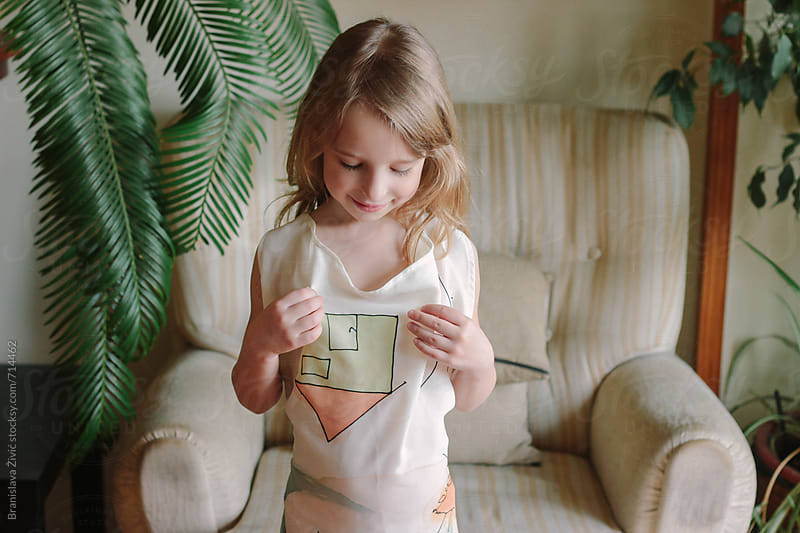 Portrait of a cute little girl indoor by Branislava Živić for Stocksy United