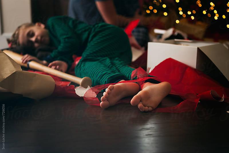 Christmas: Sleepy Boy Holds Baseball Bat On Christmas Morning by Sean Locke for Stocksy United