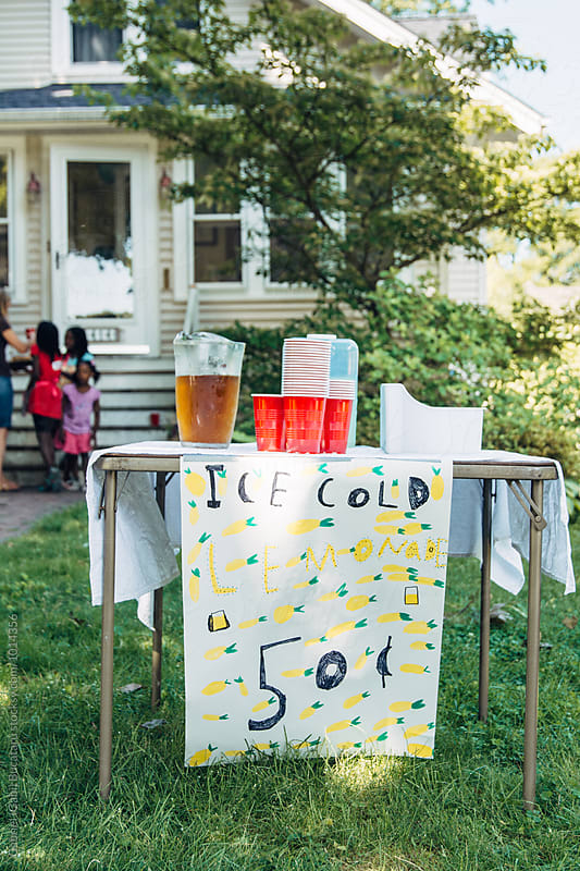Lemonade stand and sign by Gabriel (Gabi) Bucataru for Stocksy United