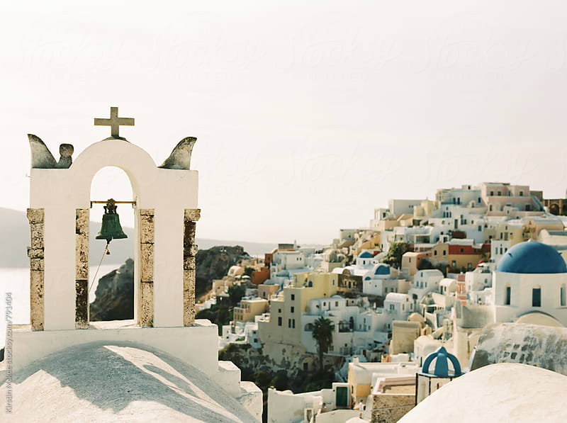 View of Oia and church bell, Santorini by Kirstin Mckee for Stocksy United