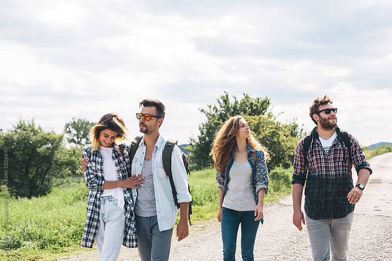 Group of friends walking on a sunny day by Aleksandar Novoselski for Stocksy United