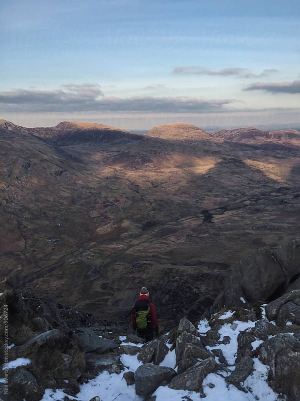 Hiker taking in the view by Neil Warburton for Stocksy United