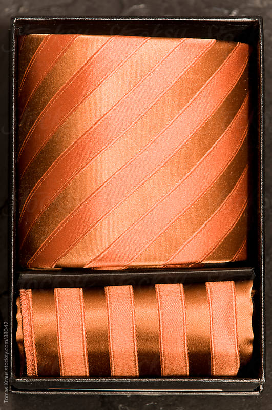 orange tie by Tomas Kraus for Stocksy United