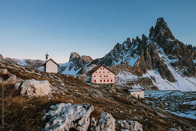 refuge with a chapel in italian alpine scenery at the famous three peaks by Leander Nardin for Stocksy United