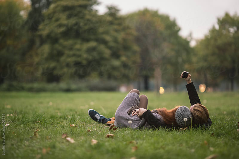 Ginger Couple Lying on the Grass by Lumina for Stocksy United